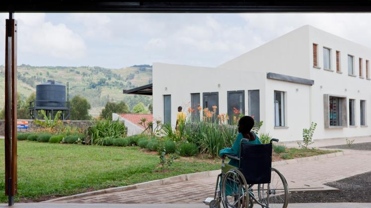 Photo of Butaro District Hospital, Photo by Iwan Baan, A patient looks out at the inner yard