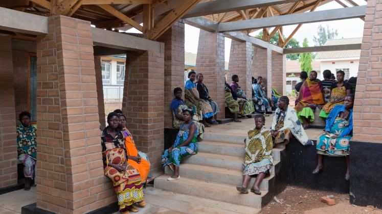 Photo of Maternity Waiting Village, Photo by Iwan Baan, mothers socializing in the outdoor hallways