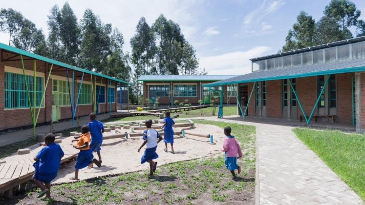 Photo of Mubuga Primary School, Photo by Iwan Baan, children playing in the inner yard of the school