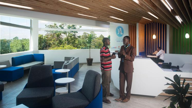 Photo of Young African Leaders Initiative, Two men chatting in first floor reception area