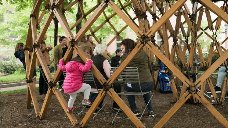 Photo of Design Biennial Boston, Child playing on the pavilion during spring concert