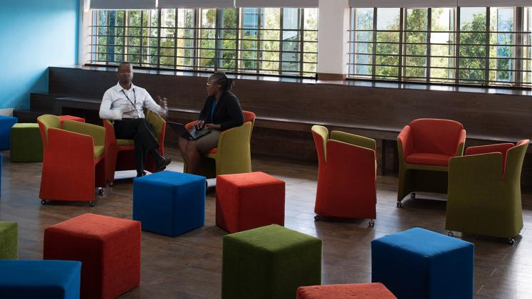 Photo of Young African Leaders Initiative, Two people chatting in open layout seating