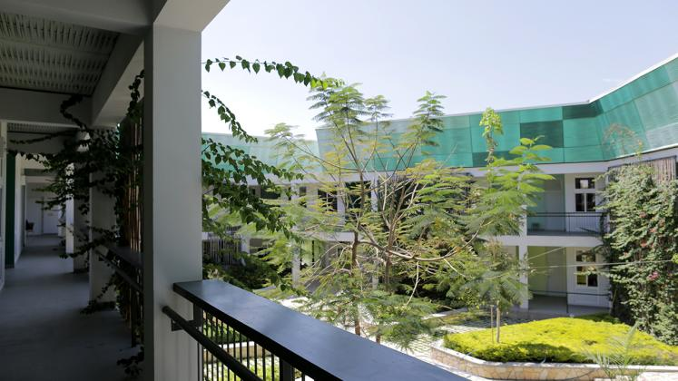 Photo of GHESKIO Tuberculosis Hospital, View of Courtyard from Second Level Exterior Hallway