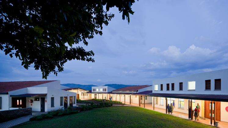 Photo of Butaro District Hospital, Photo by Iwan Baan, Courtyard Nighttime Photo Aerial View