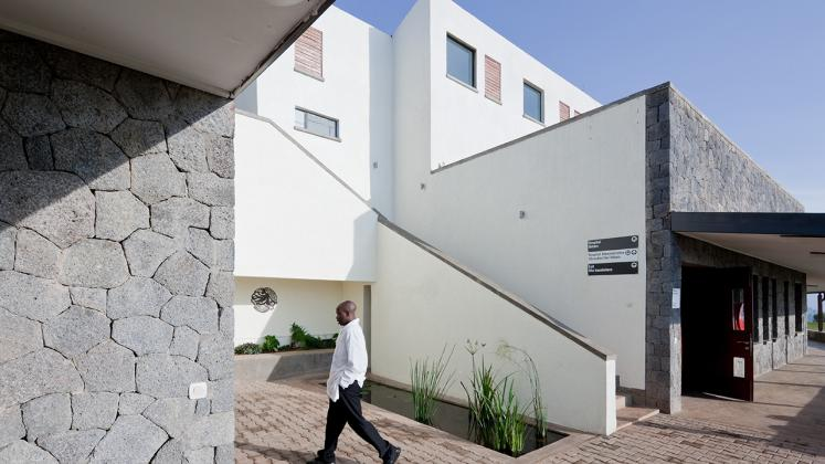 Photo of Butaro District Hospital, Photo by Iwan Baan, Exterior Staircase and Hallway with Doctor