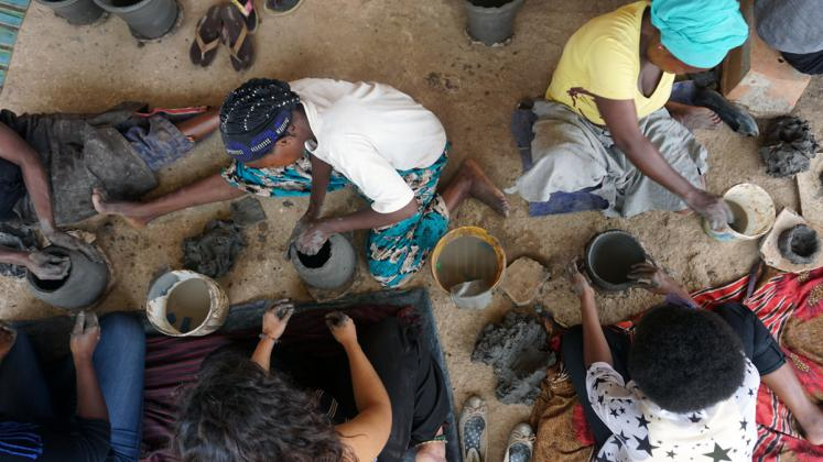 Photo: ADC fellows practicing traditional pottery techniques at Urukundu Village