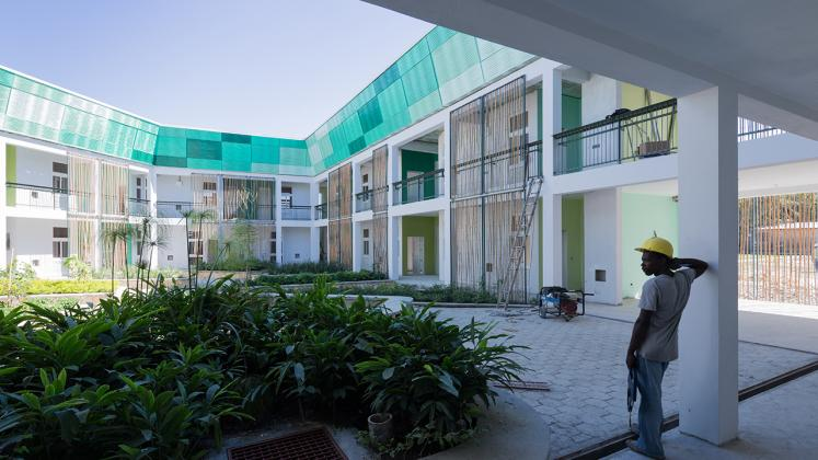 Photo of GHESKIO Tuberculosis Hospital, Photo by Iwan Baan, Process Photo of Construction Worker in Courtyard