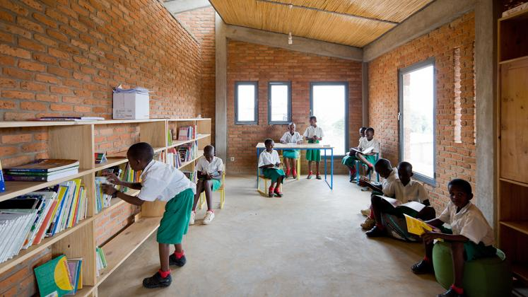 Photo of the Umubano Primary School, Photo by Iwan Baan, View of Shared Library and Classroom Space