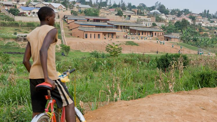Photo of the Umubano Primary School, Photo by Iwan Baan, Photo of Surrounding Landscape and Boy on his Bike