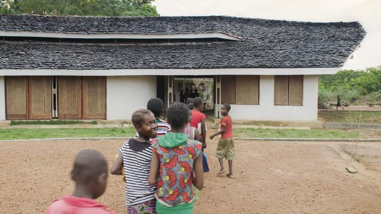 Photo of Ilima Primary School, View of hte school children lining up to go into the school from the Courtyard