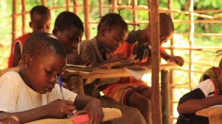 Photo of Children learning at previous Ilima Primary School classroom